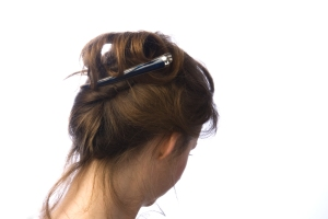 Wearing a Beak hair clip in a French pleat style