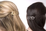 Gold or Silver Barrettes in a Half Back Hair Style